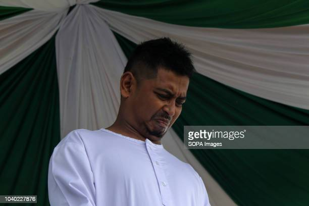 LHOKSEUMAWE ACEH INDONESIA A man seen in pain while being whipped in public for gambling which is considered to violate the Islamic Sharia law...