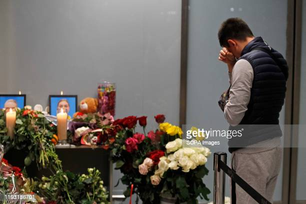 Man seen in tears at the memorial corner of flight PS 752 at Boryspil International Airport. Ukrainian international airlines flight PS 752 a Boeing...