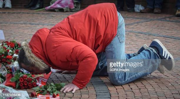 A man seen kissing a scarf of Liverpool football during the annual memorial service at the Hillsborough Hundreds of people gather outside the...