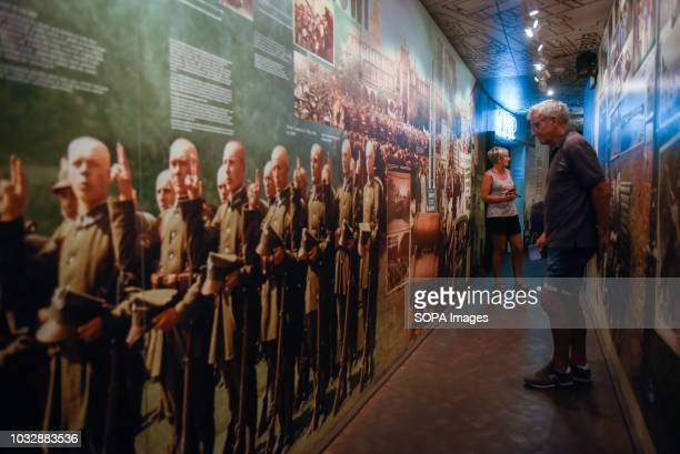 A man seen observing posters during the exhibition Exhibition at Oskar Schindler's Enamel Factory museum it is primarily a story about Krakow and its...
