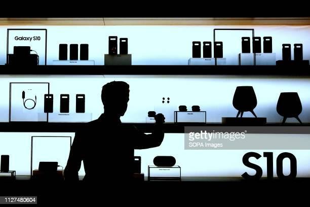 L´HOSPITALET CATALONIA SPAIN A man seen observing the accessories of del modelo S10 on a Samsung stand during the event at the Mobile World Congress...