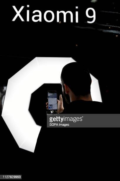 L´HOSPITALET CATALONIA SPAIN A man seen observing the new model Xiaomi 9 at the Mobile World Congress in Barcelona