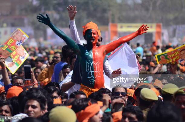 A man seen painted with the symbol of BJP during Public rally of Prime Minister Narendra Modi on March 8 2019 in Kanpur India Ahead of the Lok Sabha...