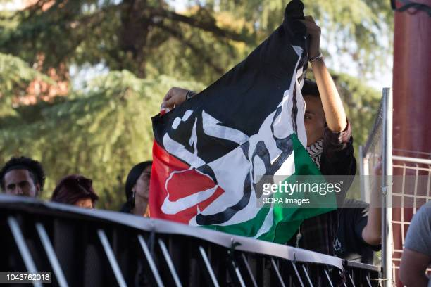A man seen raising a Palestinian flag during the tour Ahed Tamimi on her European tour during the Spanish Communist festivities Party She is an...