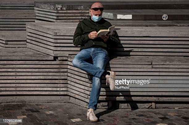 Man seen reading a book on an empty square during the first day of the 2nd lockdown in Athens, Greece on November 7, 2020. Greece enters a second...