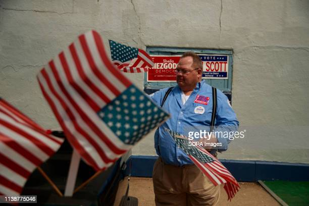 A man seen removing the flags after South Bend Indiana Mayor Pete Buttigieg who is running as a Democrat for President of the United States attended...