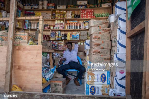 Man seen seating in a shop in the refugee camp. Dadaab is one of the largest refugee camps in the world. More than 200,000 refugees live there -...