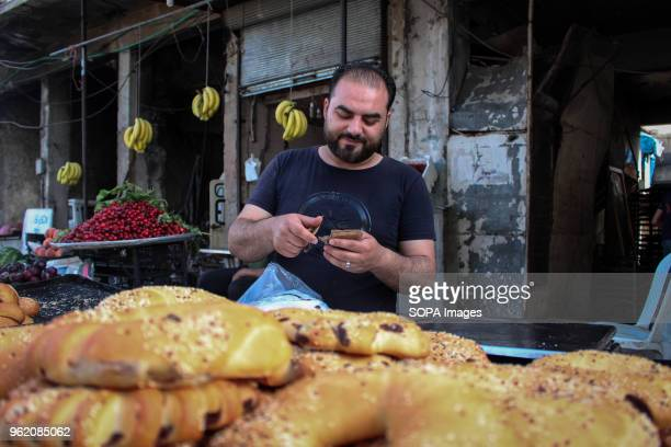 A man seen selling bread at a local market The main market of Idlib attract lots of locals people during the holy month of Ramadan During that period...