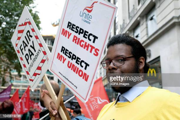 A man seen standing next to a poster saying Respect my rights respect my Union and Fair pay during the protest Wetherspoons TGI Fridays and...