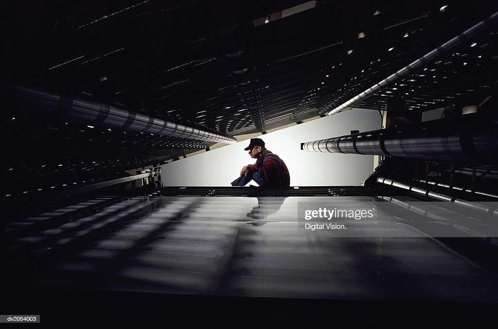 Man Seen Through a Tunnel in an Industrial Plant : Stock Photo