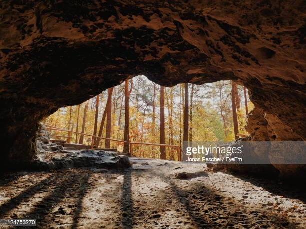 man seen through cave - nottingham stock pictures, royalty-free photos & images