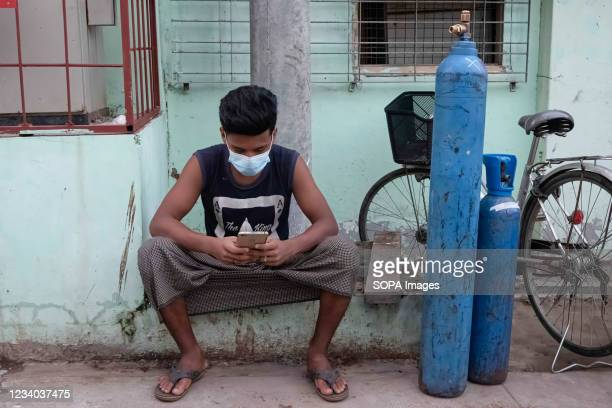 Man seen waiting to refill his empty oxygen cylinders at the oxygen-filling center, amid the surge in covid-19 cases. Myanmar is facing a shortage of...