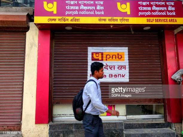 A man seen walking past the Punjab National Bank in Kolkata