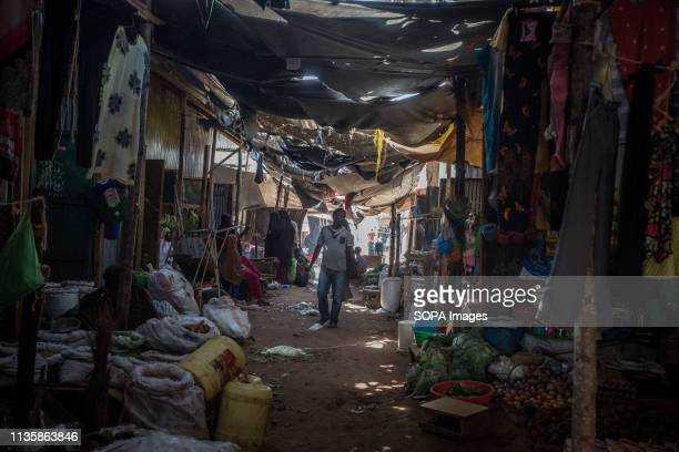 Man seen walking through a market in the refugee camp. Dadaab is one of the largest refugee camps in the world. More than 200,000 refugees live there...