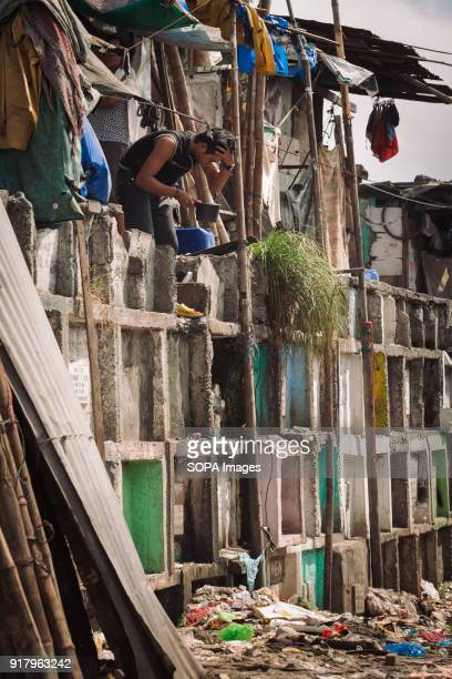 CEMETERY MANILA PHILIPPINES A man seen washing his face at the graveyard In the center of Pasay District of Metro Manila is a cemetery where over...