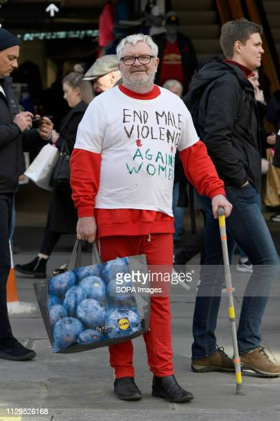 A man seen wearing a Tshirt reading End male violence against women in support of the Million women's rise march Thousands of women marched through...