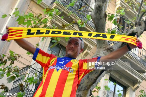 A man seen with a scarf written independence during the first anniversary of the Catalan referendum Protest during the Catalan referendum first...