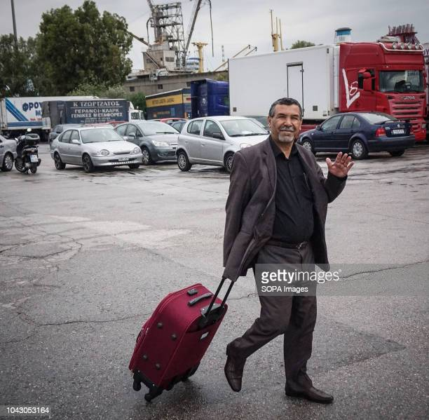 A man seen with his suitcase walking during his arrival at the port 400 migrants and refugees were transferred upon their arrival from the island of...