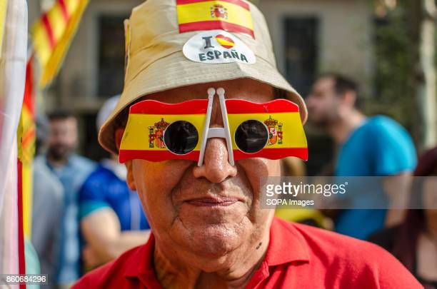 A man seen with the spanish flag glasses Hispanic Heritage Day is being celebrated across Spain Loyalist organizations urged thousands of citizens...