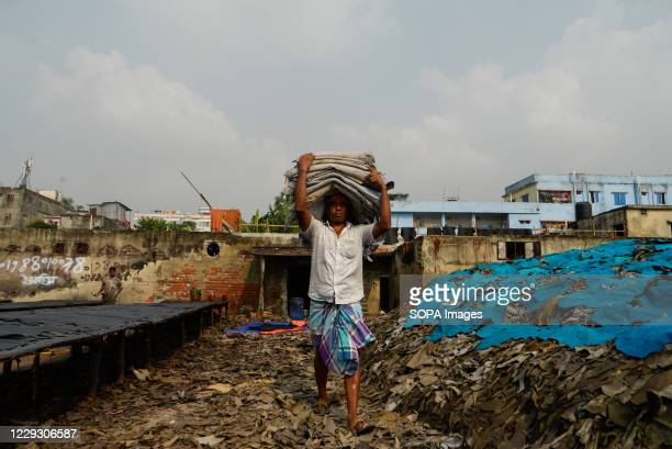 Man seen working at a tannery factory in Hazaribagh. Most people in this area have become victims of pollution due to the presence of toxic...