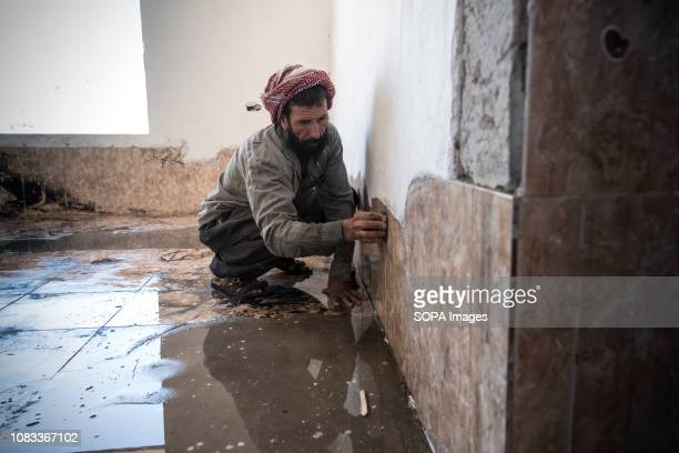 A man seen working at reconstruction site The reconstruction work is made by people of Sinyar men mostly More than 3000 people have returned with the...