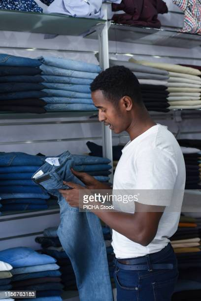 Man selecting a pair of jeans