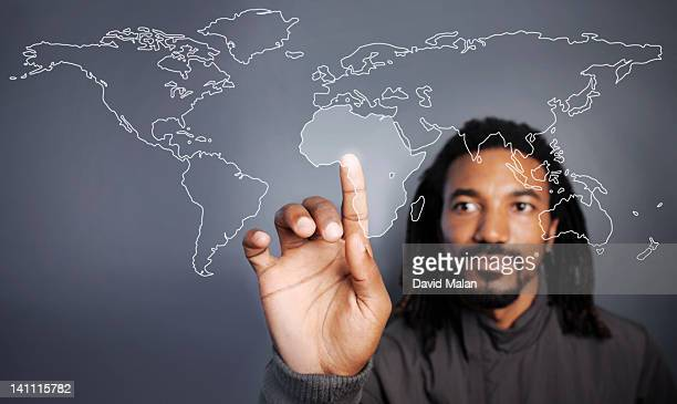 Man selecting Africa on a clear screen.