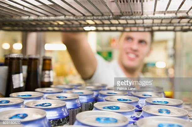 Man Selecting Item from Liquor Store Cooler