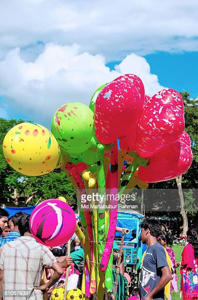 A man selling balloons in a Eid fair Muslims around the world are celebrating Eid alFitr which marks the end of the holy month of Ramadan