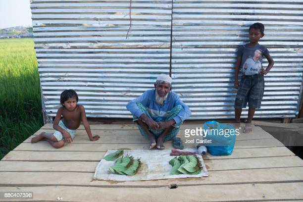 man selling betel leaf at rohingya refugee camp in bangladesh - bangladeshi culture stock pictures, royalty-free photos & images