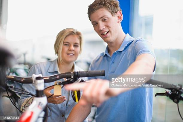 Man selling bicycle to teenage girl