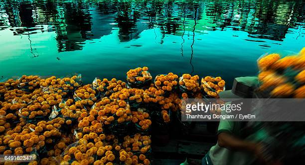 Man Selling Bouquets On Floating Market