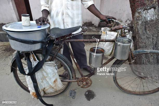 Man selling cheap indian food on the street ( India)