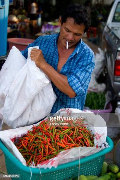 Man selling chillies at evening market near Bang Thao.