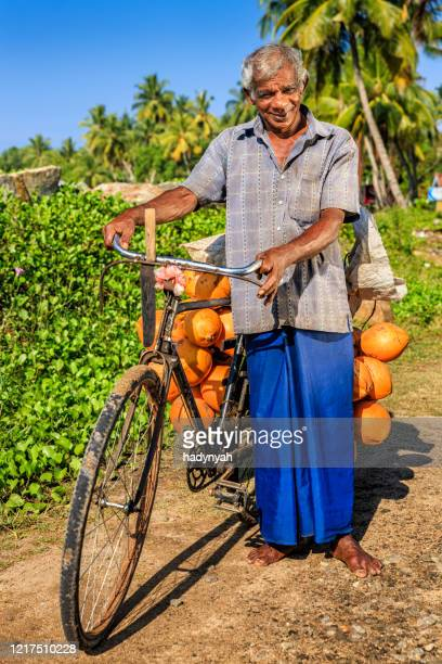 man selling coconuts from his bike near mirissa, sri lanka - vendor stock pictures, royalty-free photos & images