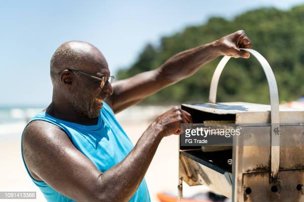 man selling curd cheese on the beach - market vendor stock pictures, royalty-free photos & images