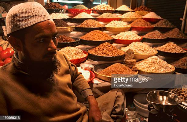 A man selling dry fruits outside Jama Masjid Old Delhi India