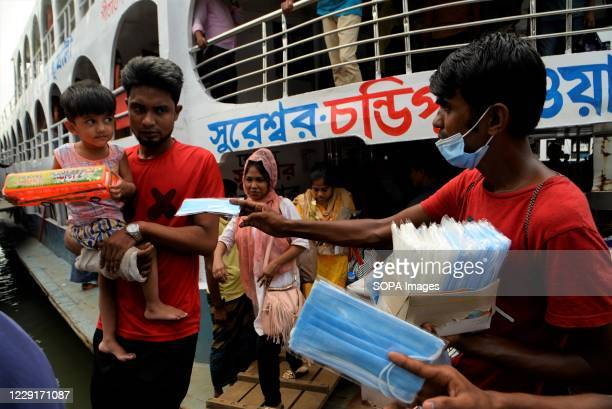 Man selling face masks at the Dhaka boat terminal. The number of Covid-19 infected people is increasing day by day in Bangladesh. People are using...