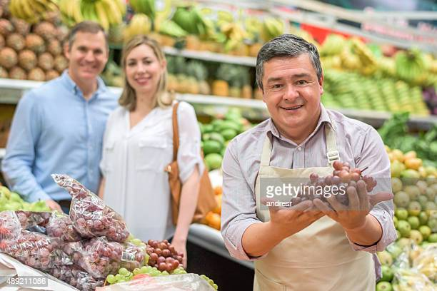 Man selling fruits at a food market