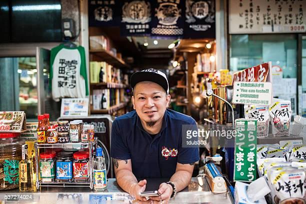 Man selling general goods in Okinawa's Makeshi market.