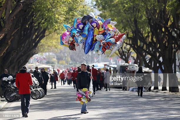 A man selling helium balloons at a local festival on February 19 2012 in Athens Greece Following a meeting on Wednesday finance ministers across the...