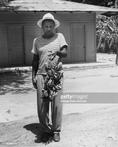 Man selling land crabs in Puerto Rico, circa 1946. The crabs are a local delicacy.