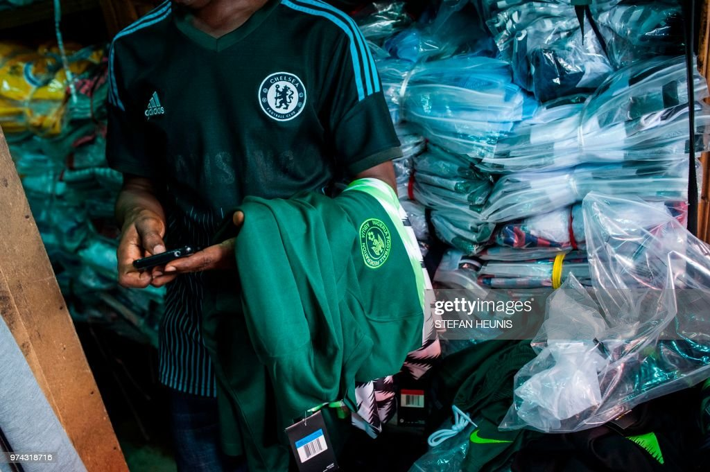 d29709afb A man selling Nigerian World Cup jerseys is pictured in Balogun ...