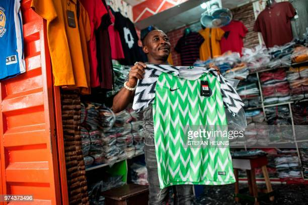 A man selling Nigerian World Cup jerseys is seen in Balogun Market in Lagos on June 14 2018 The Nigeria Super Eagles jersey for the 2018 World Cup in...