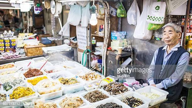 Man selling pickles in Okinawa's Makeshi market.