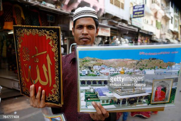 Man selling posters outside Ajmer Sharif dargah, Rajasthan. India.