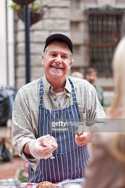 Man selling sausage at city market