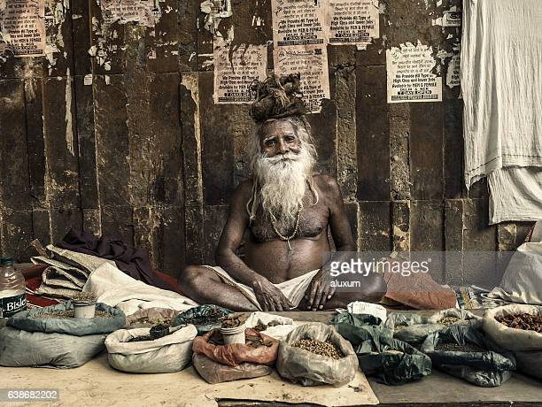 Man selling spices and dried food in street market
