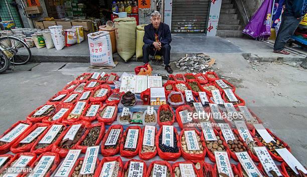 CONTENT] Man selling spices at a local market in Qingxi China