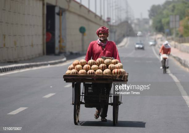 Man selling summer fruit in the scorching hot weather at NH-9, During the lockdown in the wake of Coronavirus pandemic on April 15, 2020 in New...